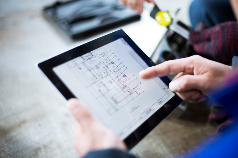 Technician using advanced technology to view a mechanical drawing - Toronto HVAC Company Springbank Mechanical